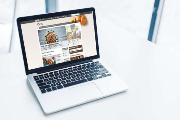 laptop-with-bbc-food-website-on-white-tablet
